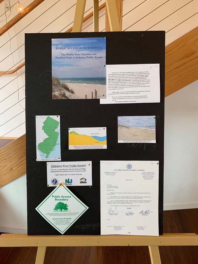 Multiple pieces of paper with info pinned to pinboard