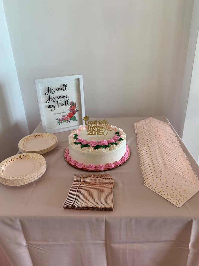 Wedding cake on table with silverware and plates