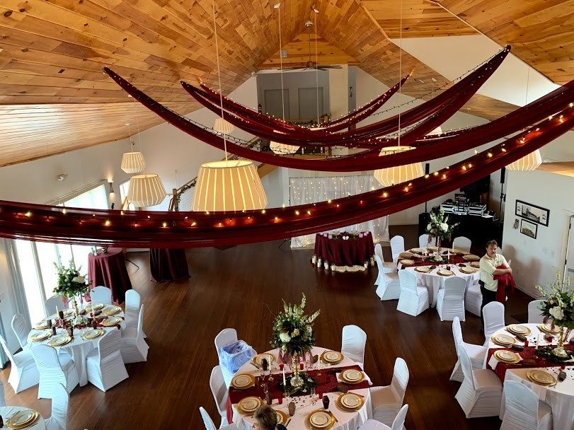 The Inn ballroom decked with red cloth and ribbons