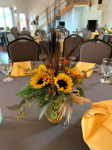 Floral arrangement at the center of table setting