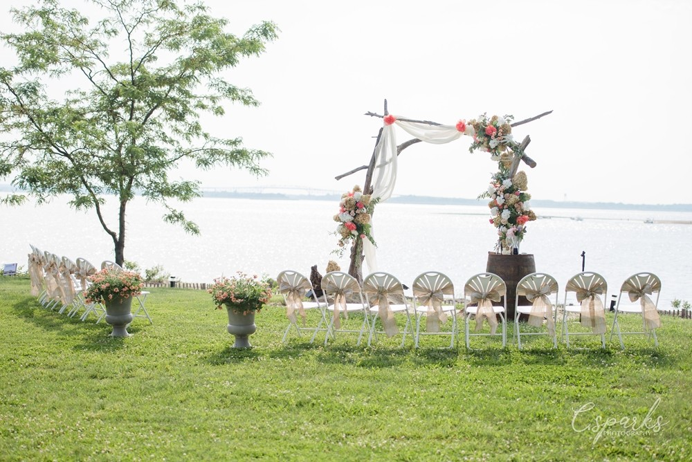 Outdoor wedding setup with manor infront of bay