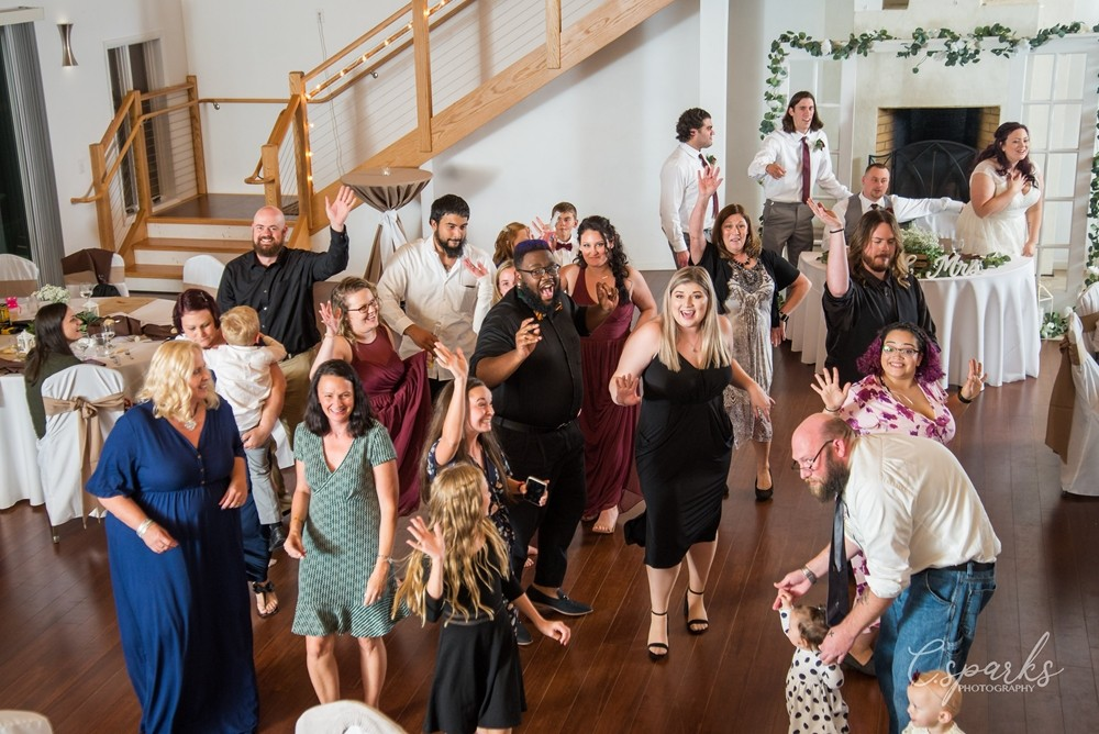 Everyone dancing on dancefloor at wedding reception