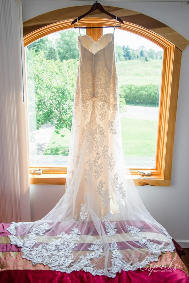 Bride's gown hanging up infront of large window