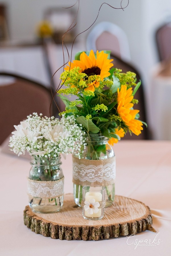 Floral arangement at center of table setting