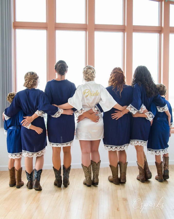 Backside of bride at center of bridesmaids posing