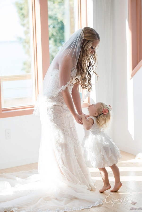 Bride dancing with little girl in white dress