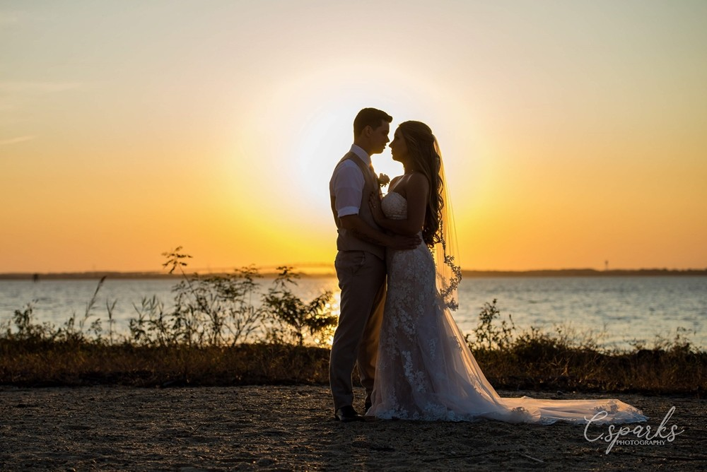 Bride and groom silhouettes infront of sunset