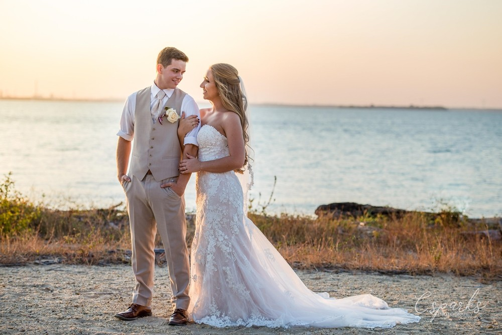 Bride and groom standing outside infront of sunset