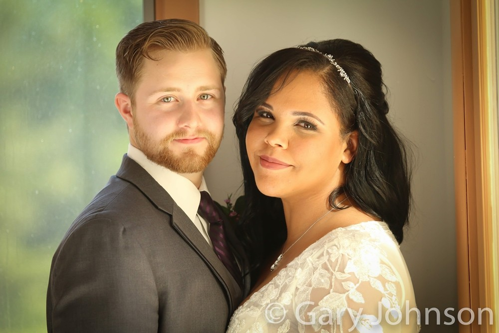 Portrait shot of bride and groom smiling