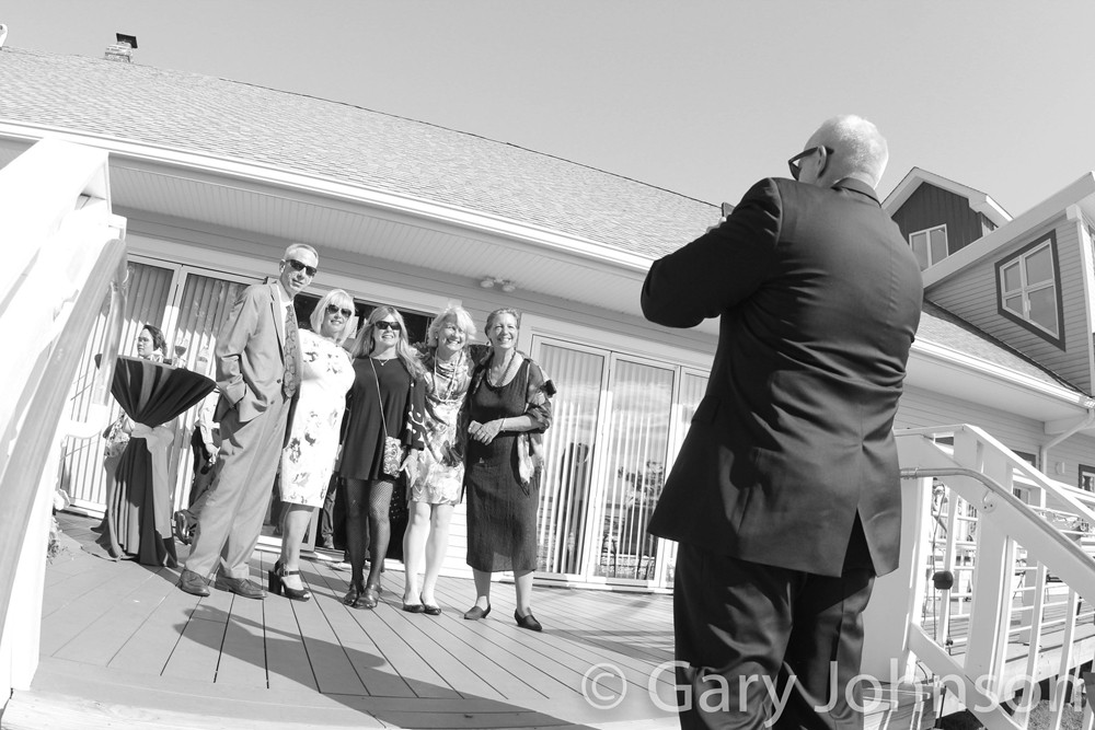 Black and white photo of man taking photo of family