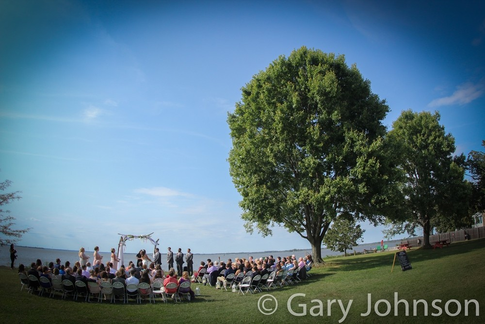 Outdoor wedding next to body of water