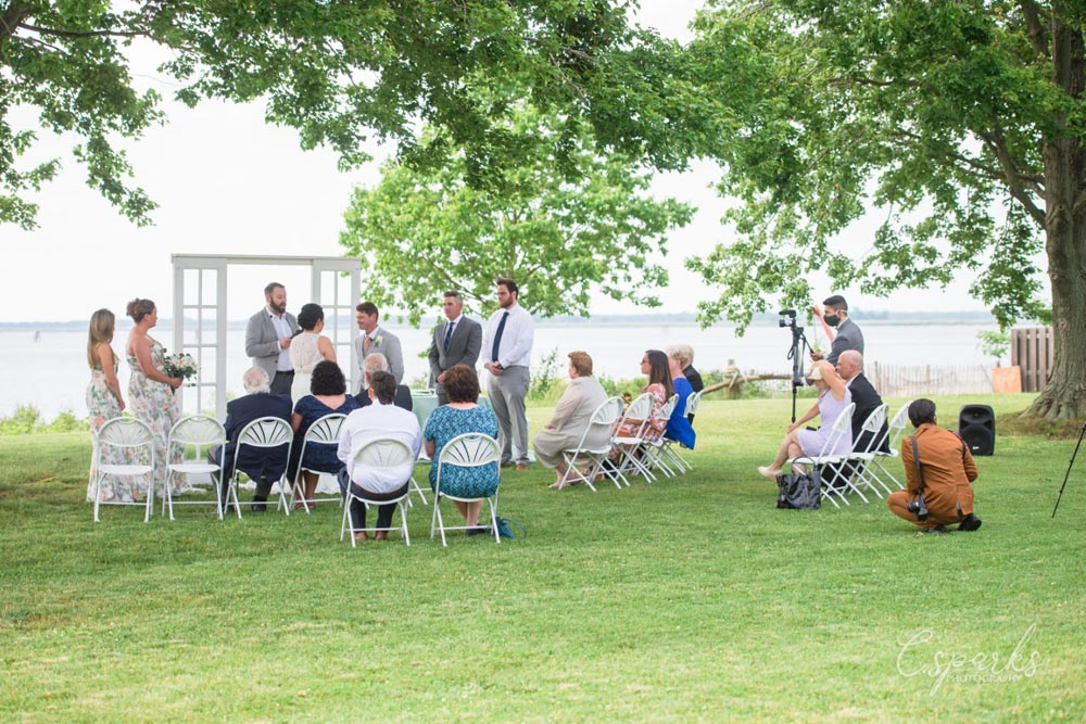 Wedding ceremony outdoor with sparse crowd due to coronavirus restrictions