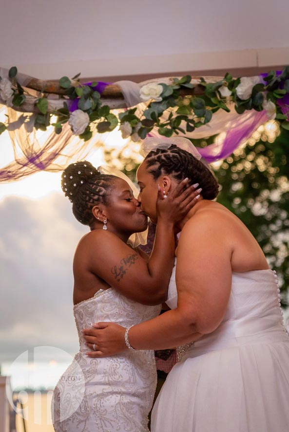 Two brides kissing and embracing