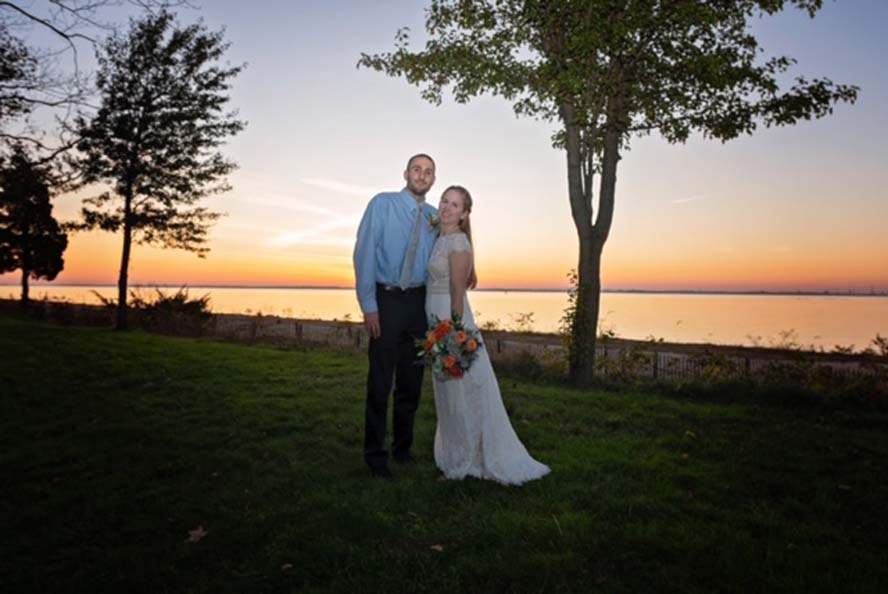 Bride and groom infront of sunset