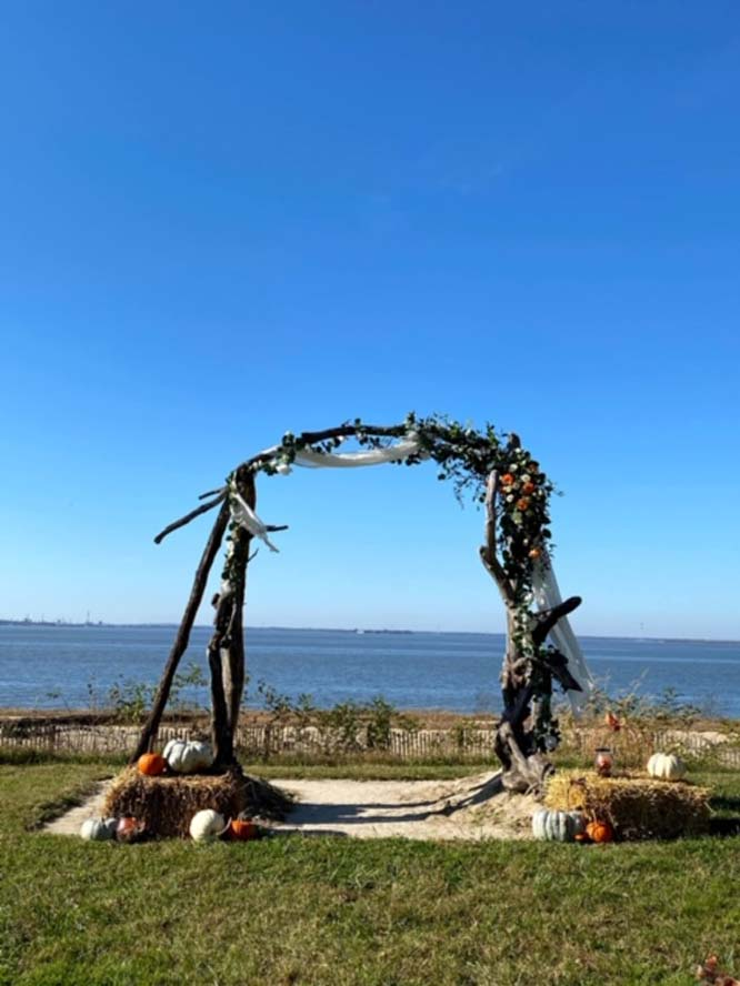 Marriage arch infront of body of water