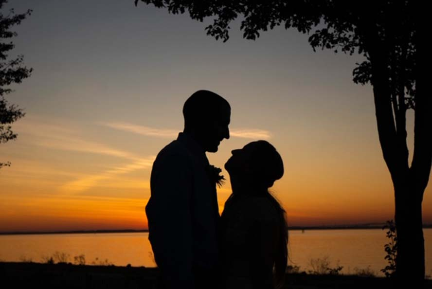 Silhouette of couple infront of sunset