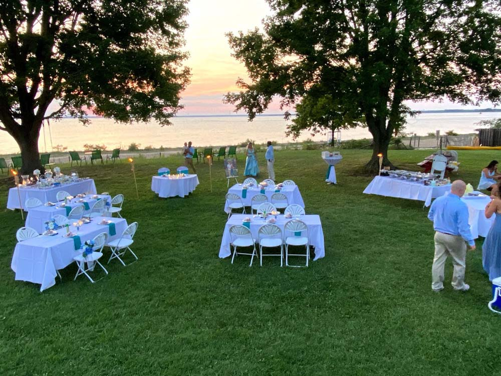 Event tables with white table cloth setup outdoors