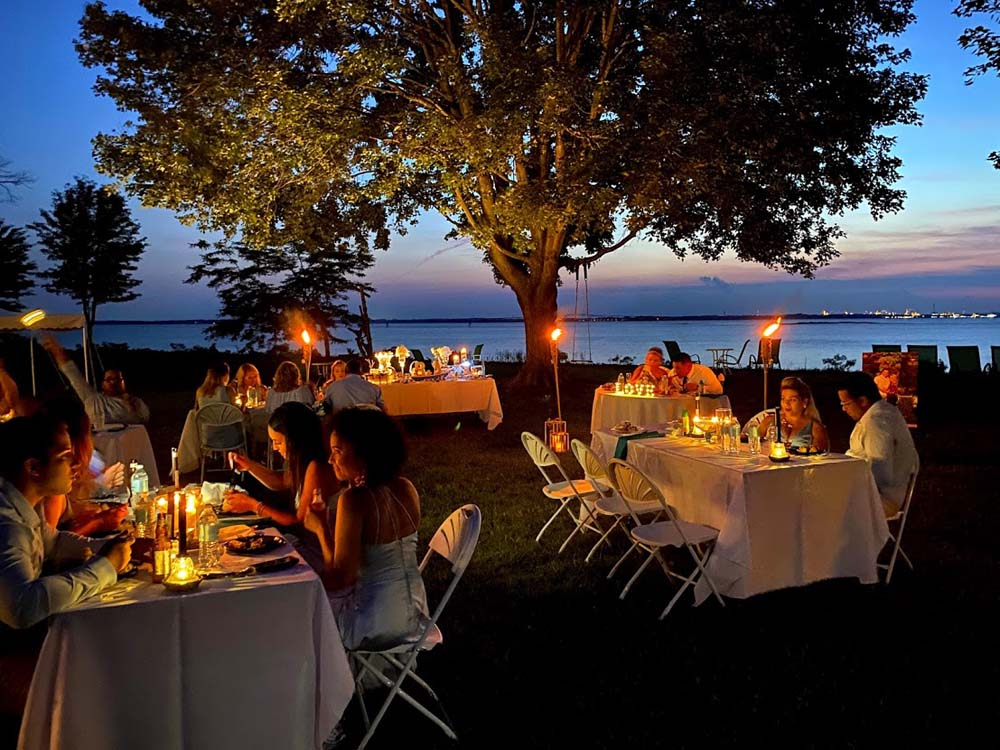 Event tables with candles outside during sunset